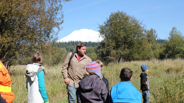 Drew Eastman leading students on an exploration of the Mt. Adams foothills.